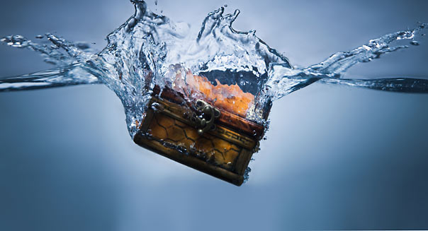 Treasure chest sinking in water. Image shot 2010. Exact date unknown.